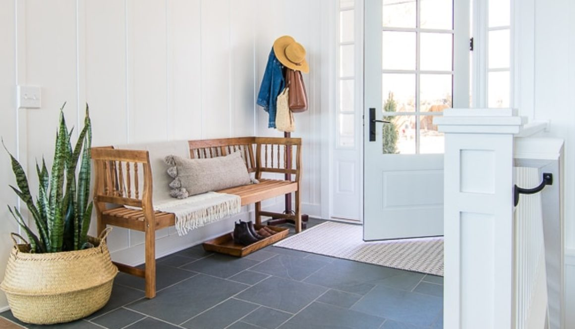 white-board-and-batten-entryway-blue-slate-floors-rustic-bench-5